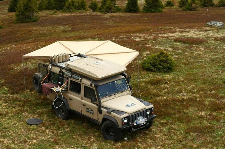 Nice Tent This New Wrap Around Wing Looks Great I See The Washing Area On The Other Side Away From Liv Land Rover Land Rover Defender Motorcycle Camping Gear