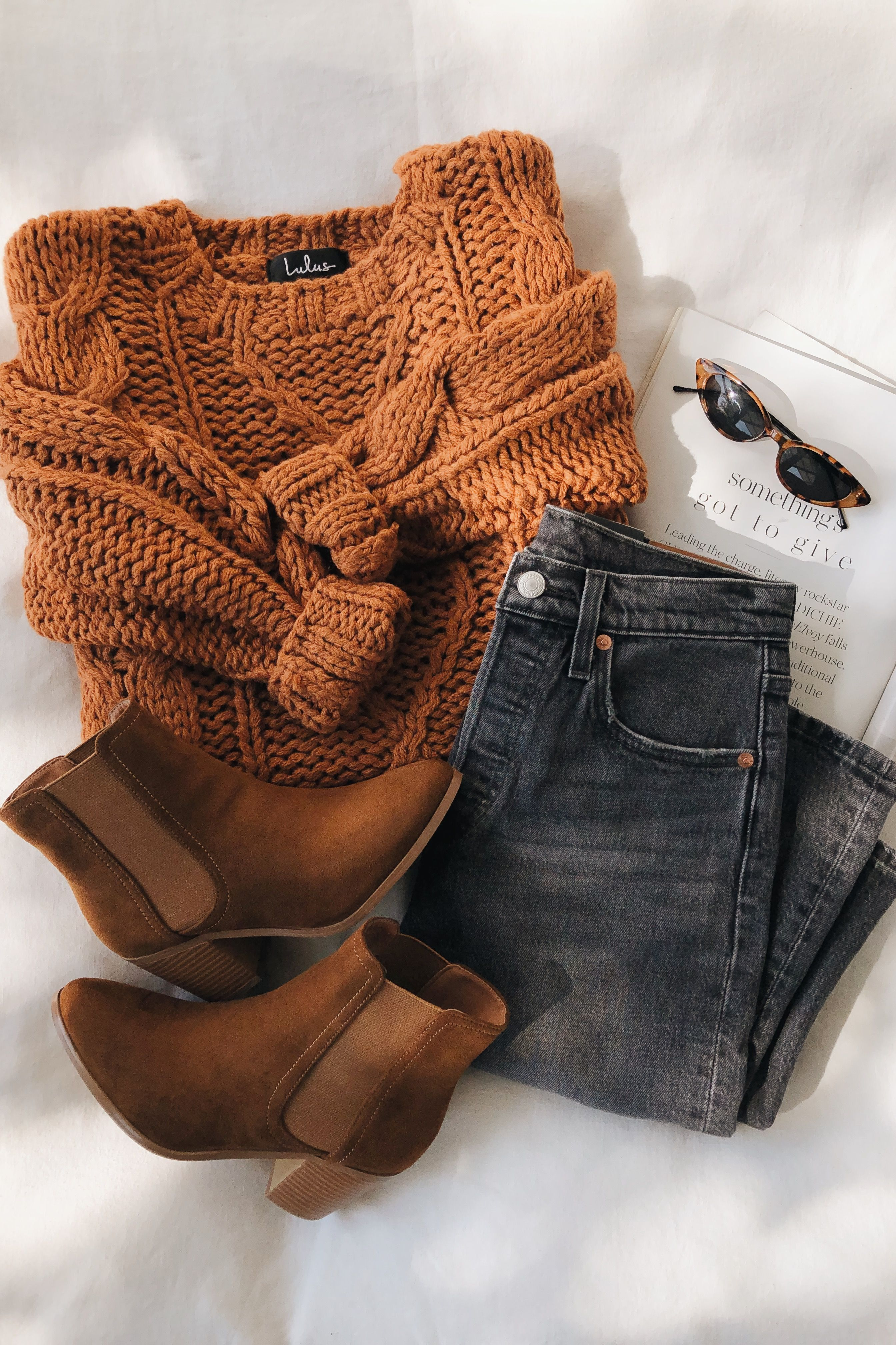 Jaylene Rust Brown Cable Knit Sweater #branddresses This chunky cable knit sweater and brown booties are essential for fall outfits. These essentials are not only versatile, but warm and cozy. #lovelulus #cutecups