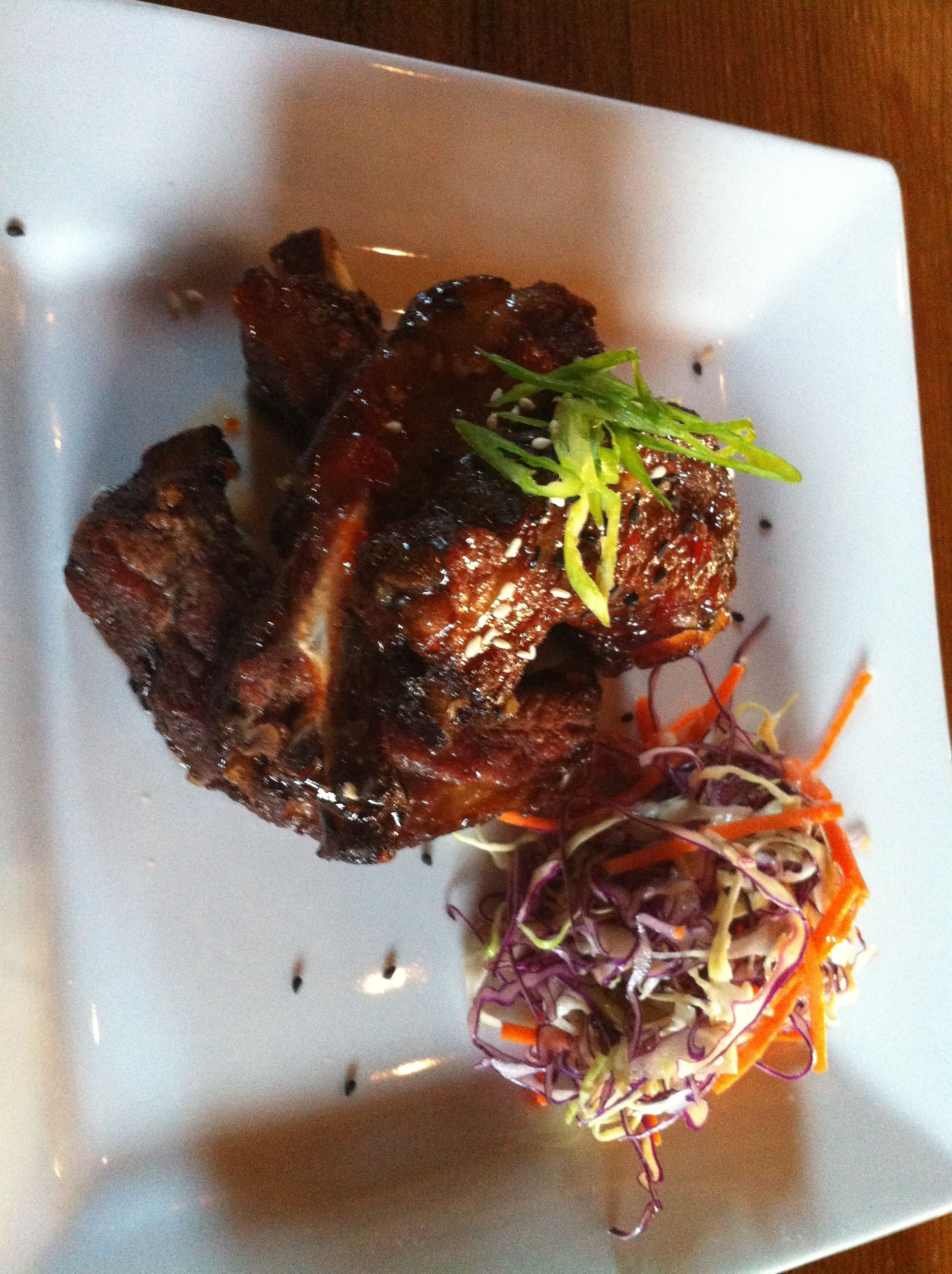 Alexander's at Timber Cove Inn. Beer Braised Baby Back Ribs with a Sweet Chili Glaze. Served with Thai Slaw. Off the hook delicious.