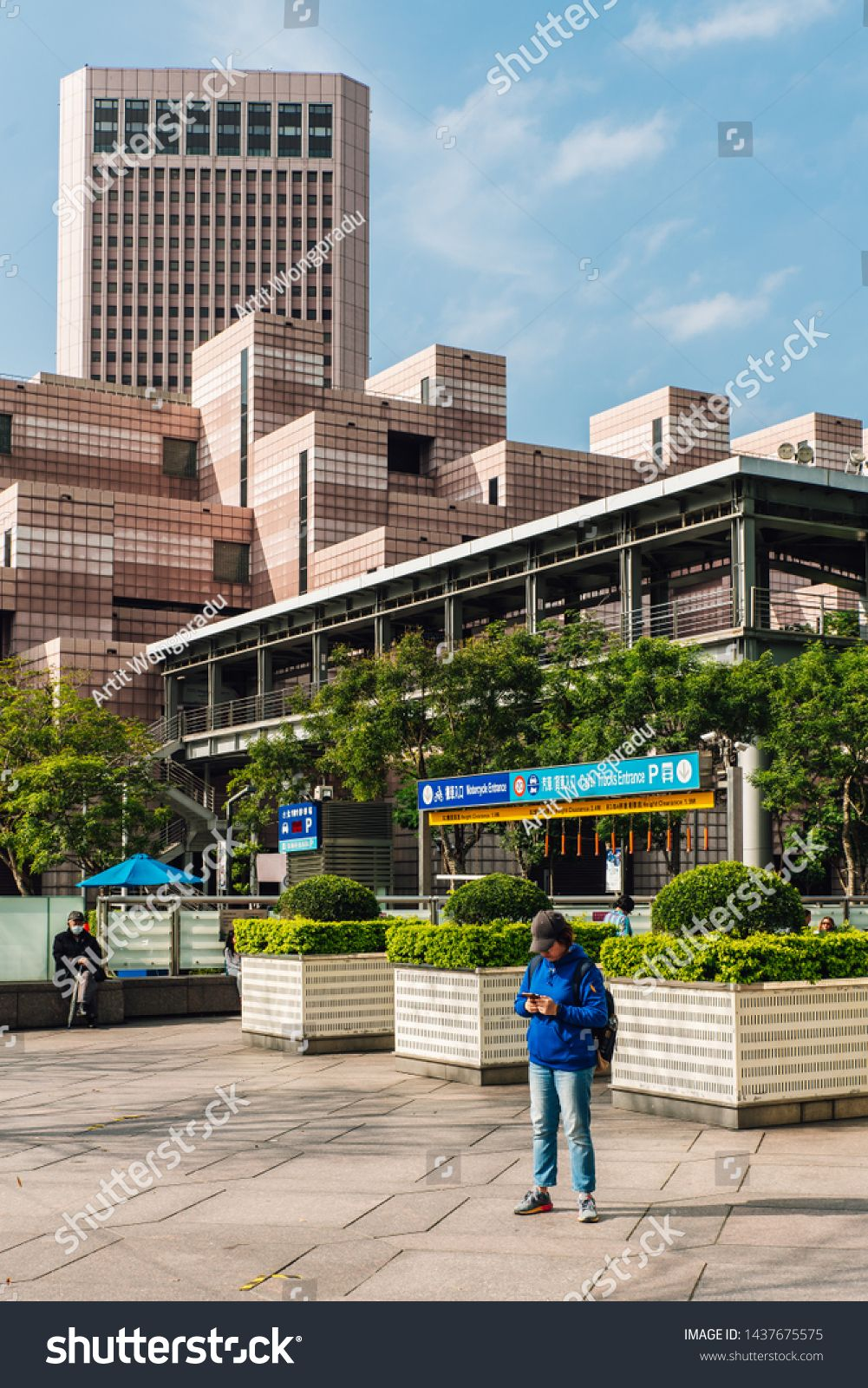 TAIPEI, TAIWAN. DEC 26, 2017: Building of Taipei World Trade Center Post Office. Decorated with white and light red color tiles with tourist standing in foreground. #Sponsored , #ad, #Taipei#Building#World#Center