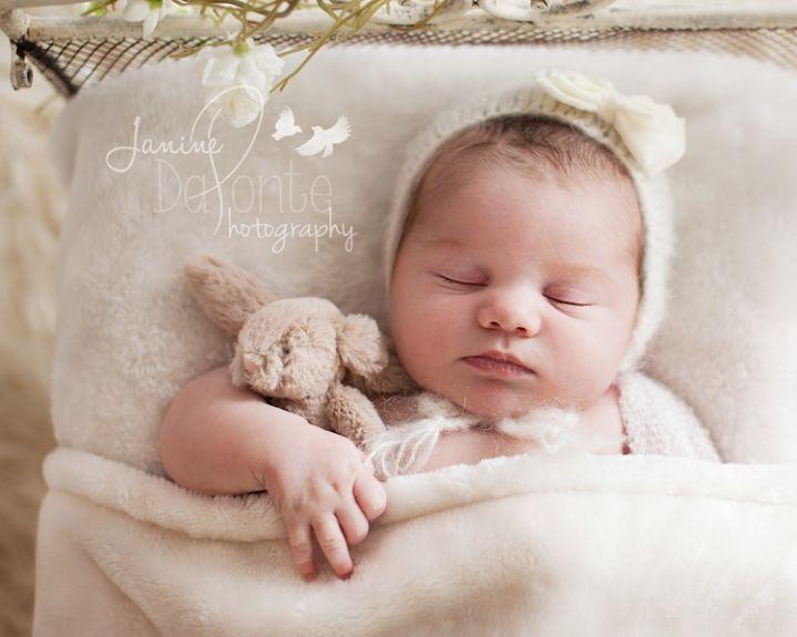 Newborn girl tucked in bed mississauga newborn photography