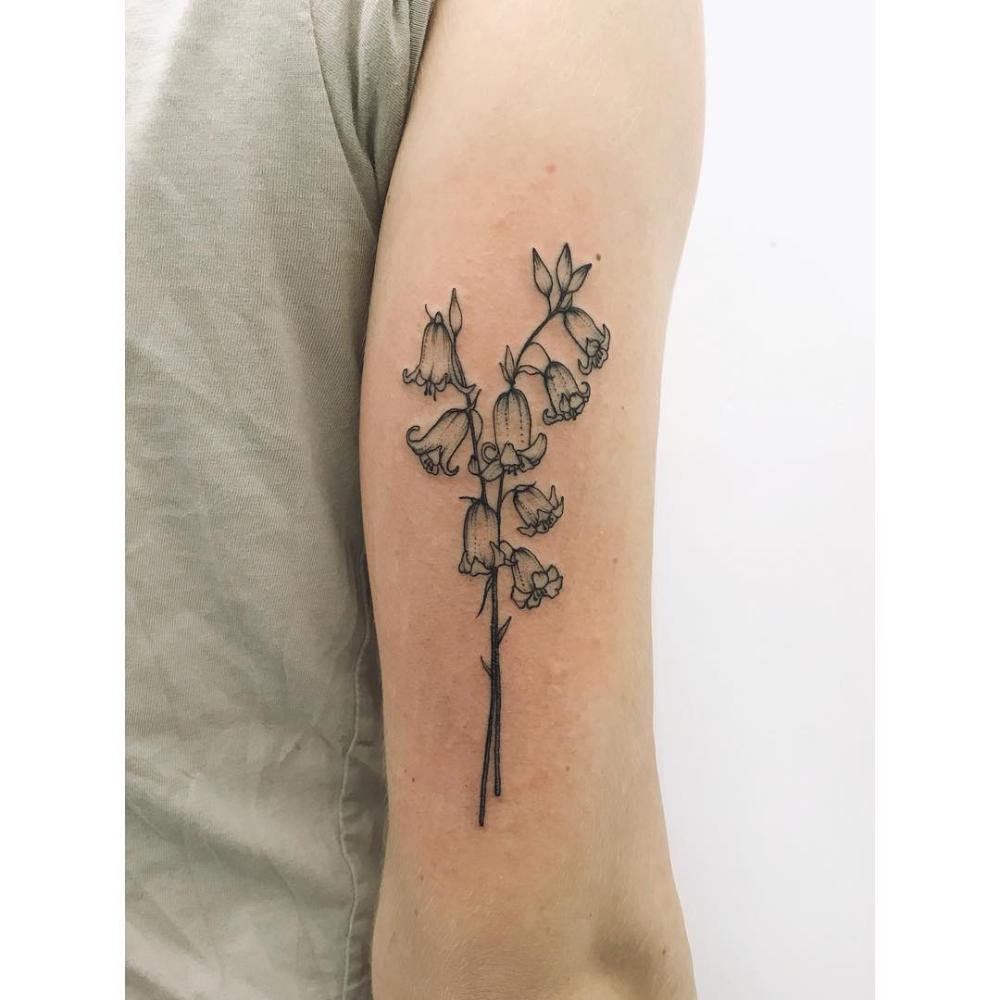 Little bluebells tattoo on the arm