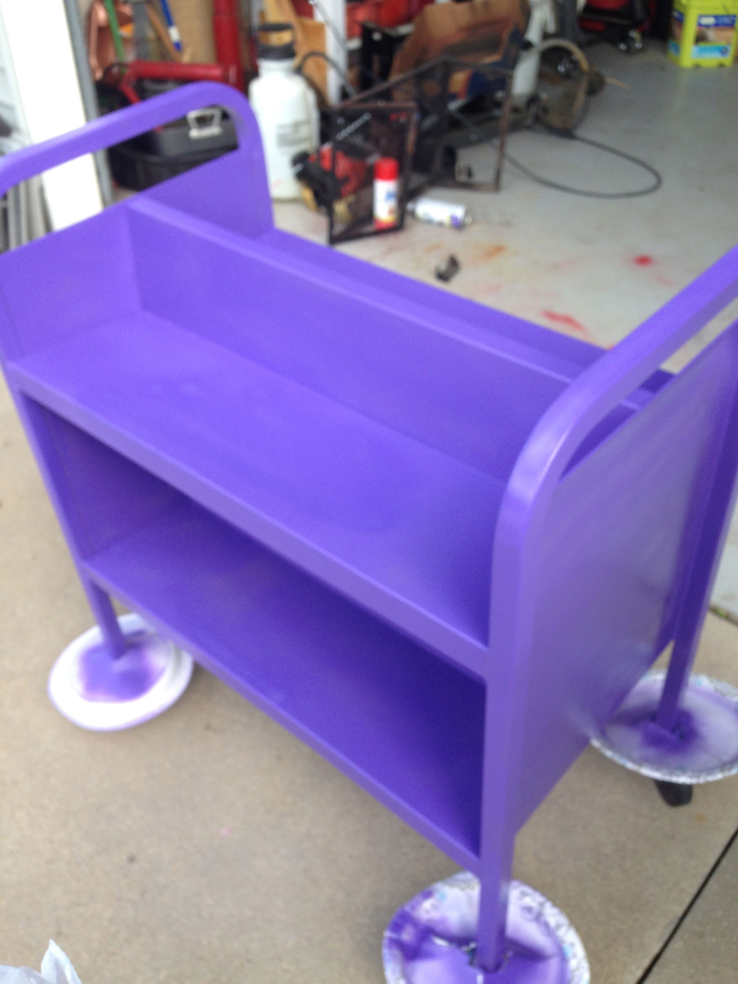 Freshen up the old book carts with donated fun spray paint