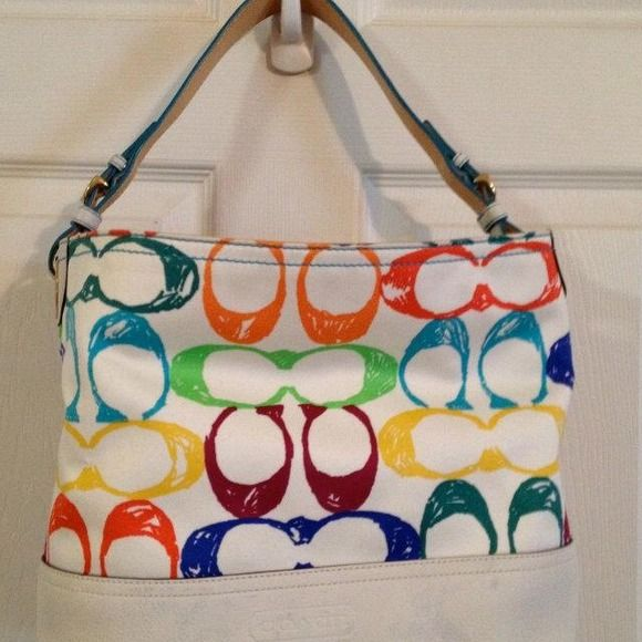 100% authentic Coach Tote Fun summer purse you can't pass up. Here are some dirt marks on the bottom white leather but doesn't take away from the purse! Coach Bags Totes