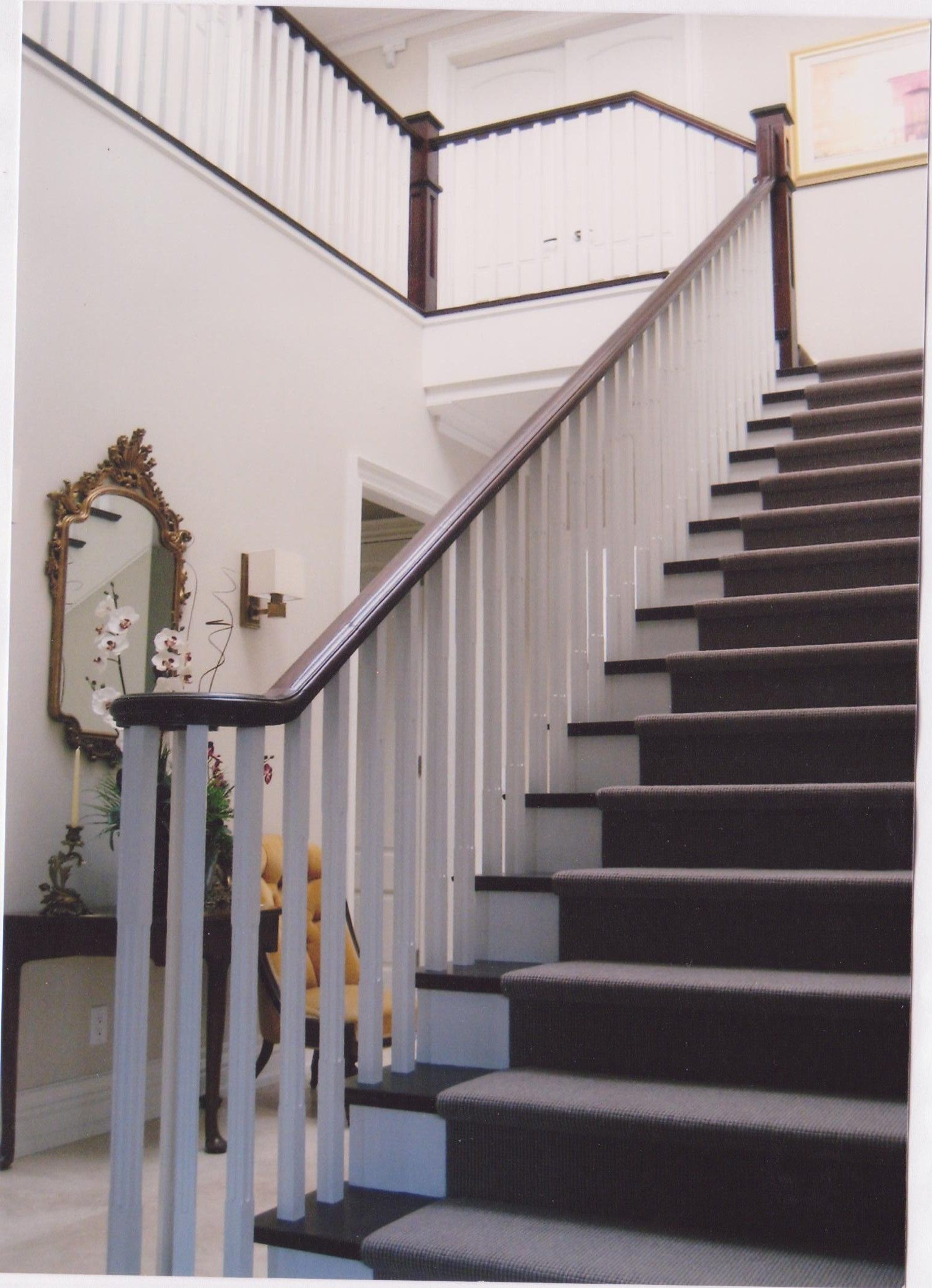 painted staircase with white oak pickets and