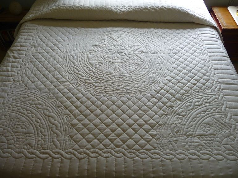 Our Amish made Queen Anne Star Wholecloth quilt is filled with ... : hand quilting stitches per inch - Adamdwight.com