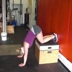 hand stand pushup knees on box (top)
