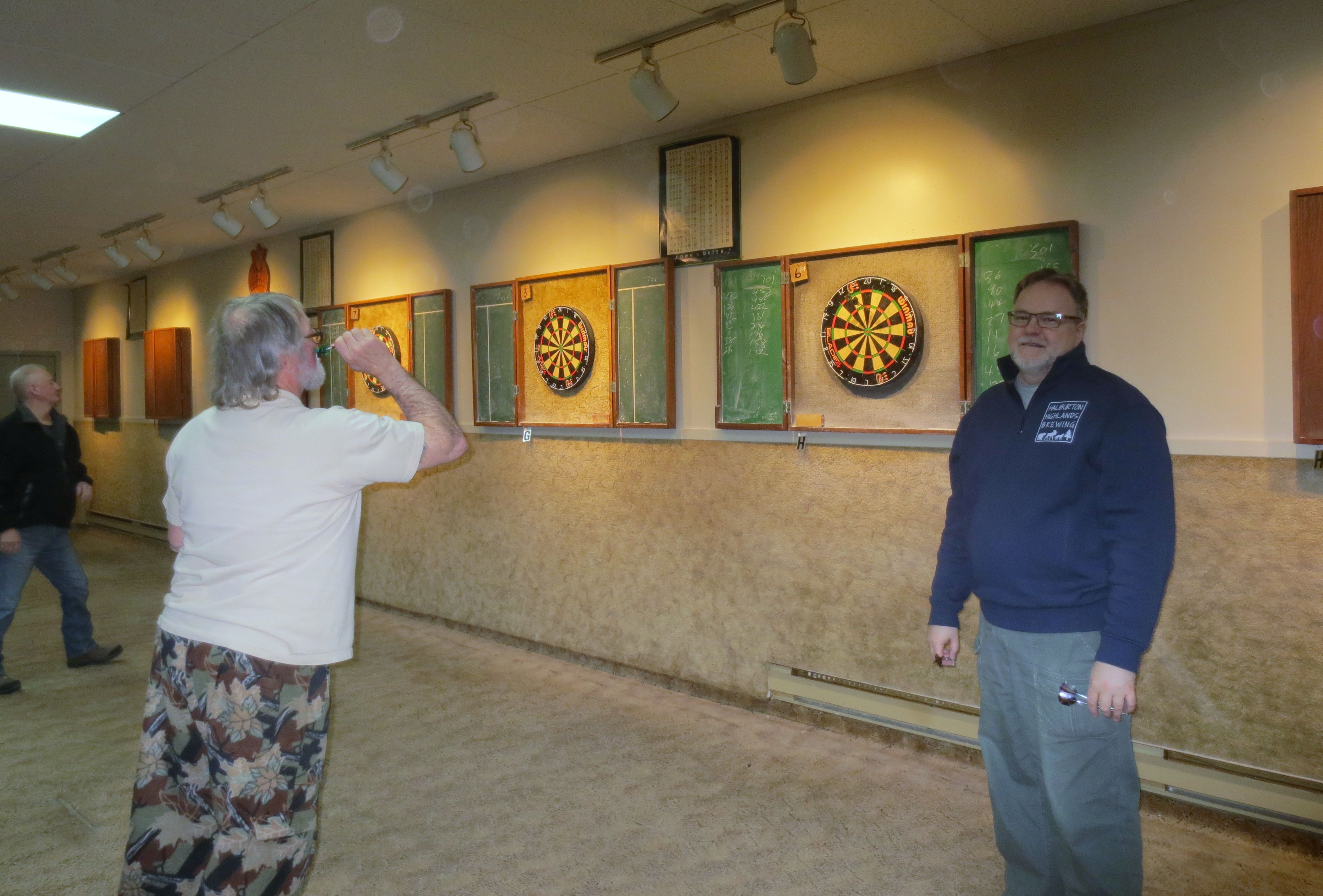 Members playing darts at the Fun Friday Dart Night
