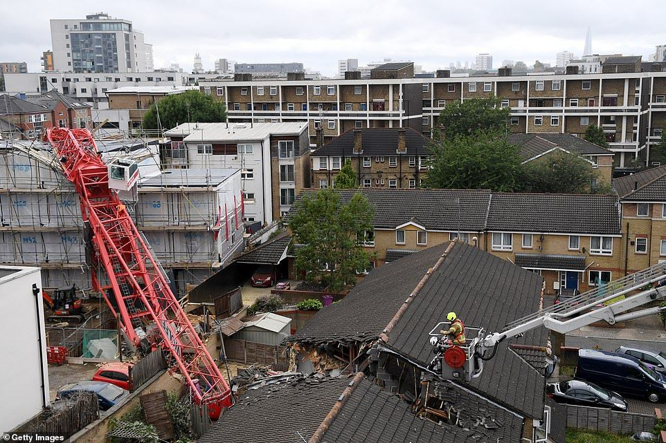 A woman dies as 65foot crane COLLAPSES in London in 2020