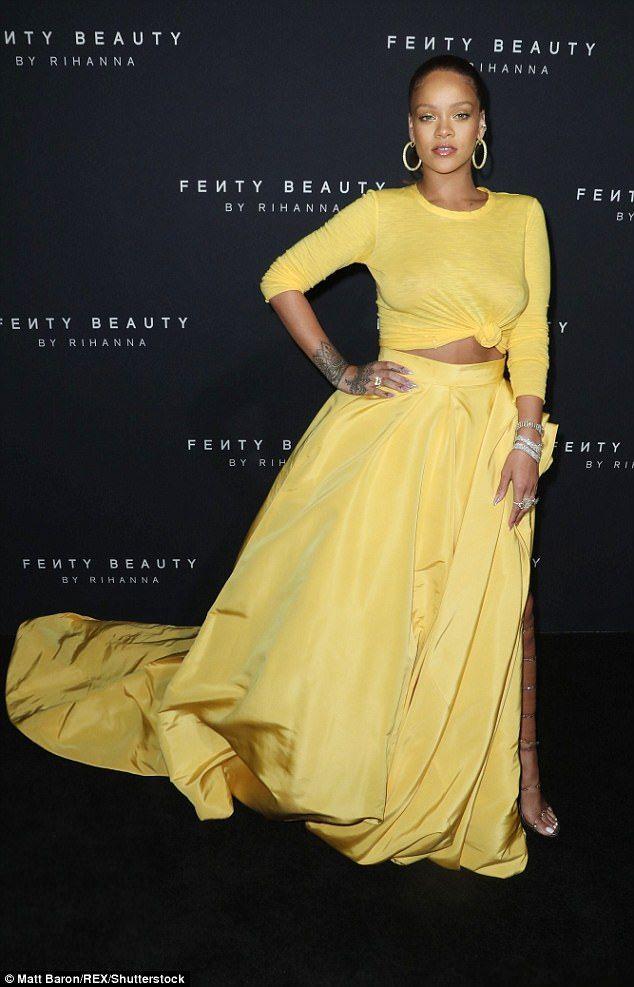7f14913622 Rihanna glows in yellow skirt for Fenty Beauty NYFW launch