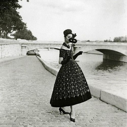 A masquerade in Paris, 1958. Gown by Dior    theniftyfifties.tumblr.com