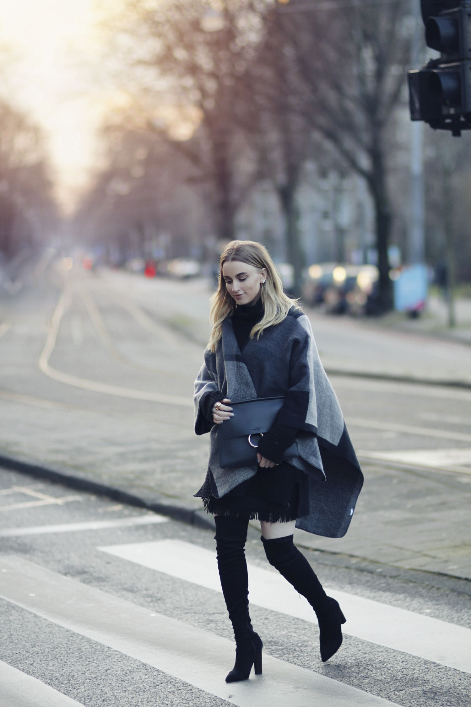 4e4ac9c0dd0 Noor De Groot is wearing thigh high boots with the poncho coat trend