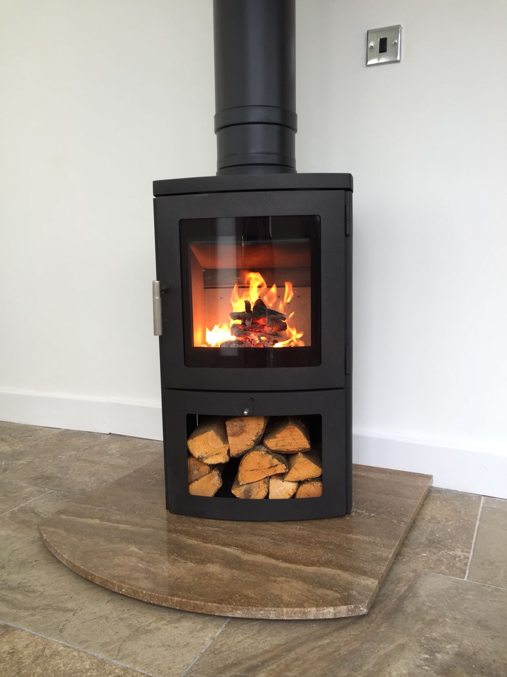 #chesney Milan 4 #Woodburning #stove on a Chocolate Travertine hearth with  Twin wall