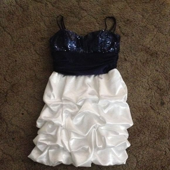 Blue and white homecoming dress Sequins up top middle portion being a ribbon type effect and ending with a white ruffled portion with bubbling effect. // has loose stitching at the end of the zipper but isn't noticeable just must be handled with care when putting on.// worn once. Dresses