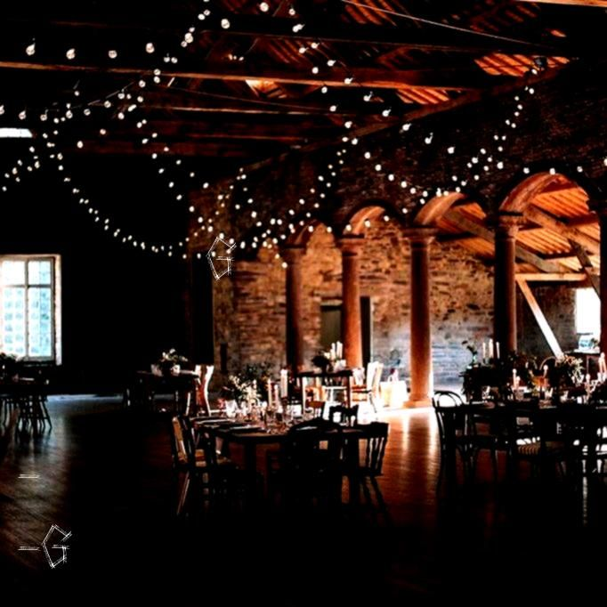 garland ceiling  Guinguette garland ceiling   FYWI 50 Weddings Across 50 States That Showcase US Wedding Style  Alice  JeanBaptiste   Barn Wedding Reception Market lighti...