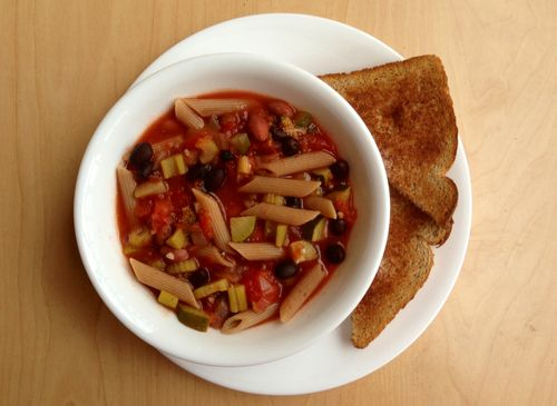 Tomato, broccoli, zucchini, celery, onion, garlic, black bean, pink bean, and whole wheat penne soup with a slice of whole wheat toast and earth balance.