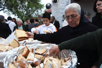Churchgoers enjoy the artos bread (served in large baskets outdoors).