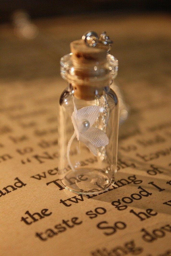 Vial Necklace - White Fairy Tale Flower. $15.00, via Etsy.