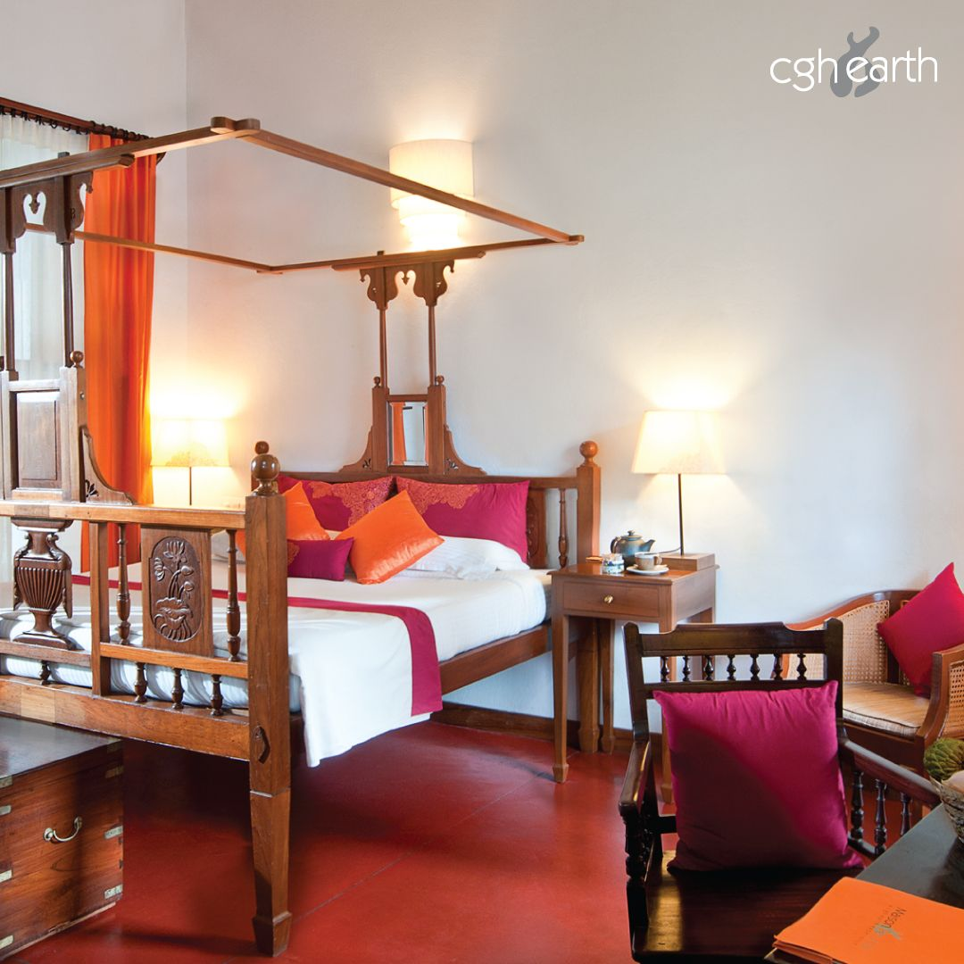 The red oxide floors and wooden fourposter beds at
