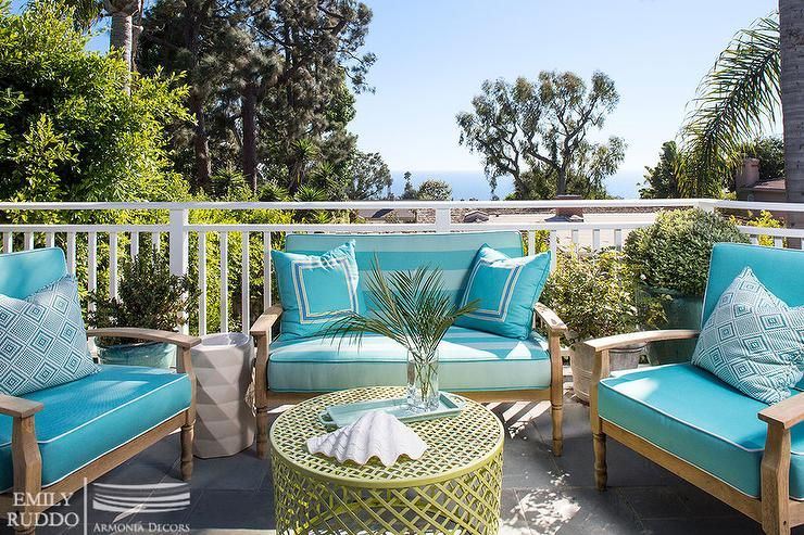 Chic Patio Features A Teak Sofa And Chairs Lined With Turquoise Blue Cushions Lined With T Diy Patio Furniture Cushions Blue Patio Decor Teak Outdoor Furniture