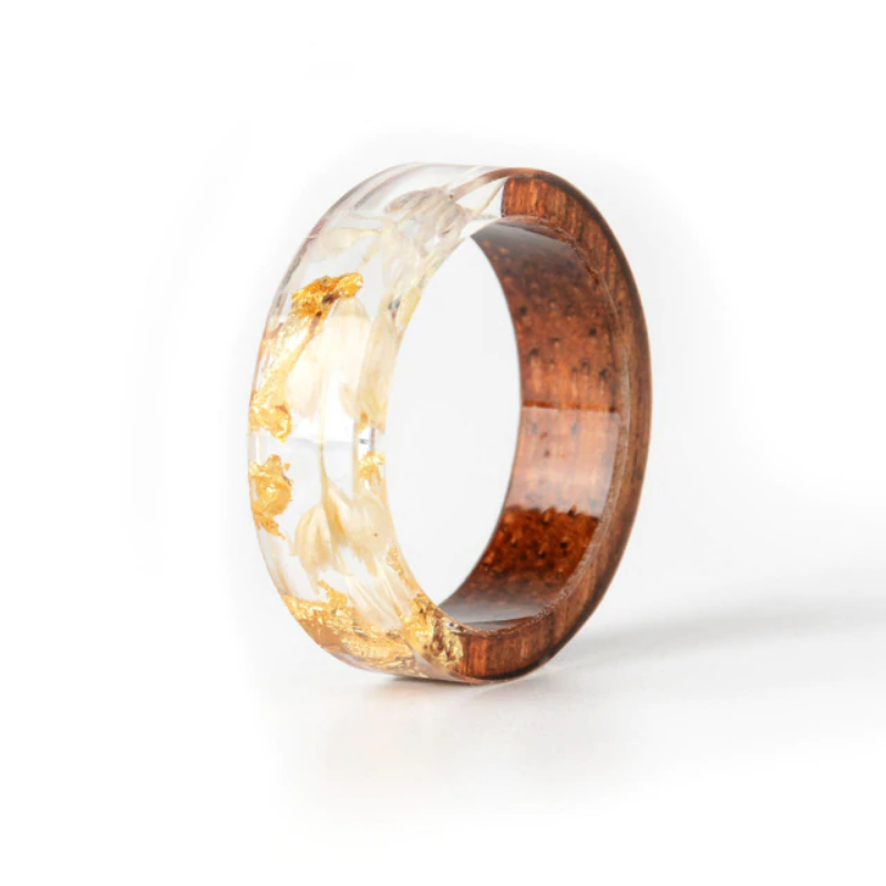 Handmade Wood Resin Ring with Flowers Plants Inside, Engagement Ring Rings are designed with simple designs, beautiful processing will be the perfect choice for girls when participating in parties, a mere reflection of the beauty who wears it, elegance and equally modern. These Handmade Dried Flowers Wood Ring are handmade by woods craftsmen. The Ring display a dried flower design. Makes the perfect gift for any outdoors lover. Highlights: 100% New Style Design Gift for Friends, Wife, Mom Best g