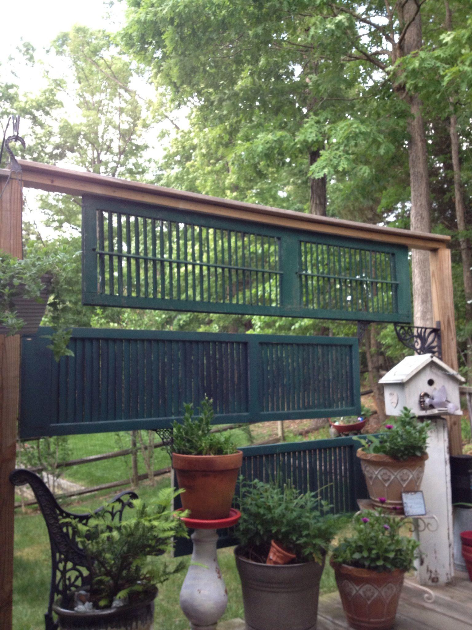 old louvered doors repurposed into garden screen | cedar fence