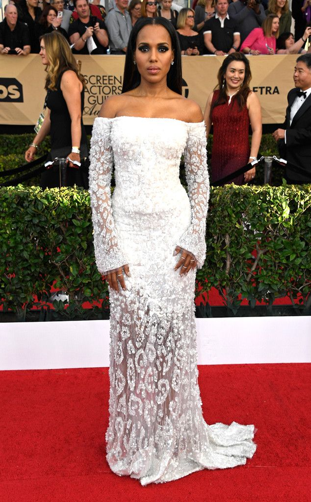 2726b2e1aa 2017 SAG Awards  Kerry Washington wore a white long sleeve Vivienne  Westwood off shoulder gown with sheer floral appliques. The white pops  really well ...