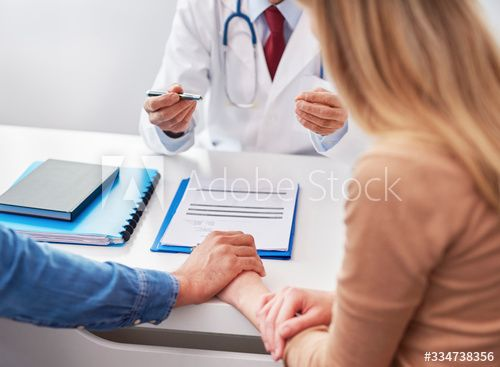 Couple in a doctor's office - Buy this stock photo and explore similar images at Adobe Stock