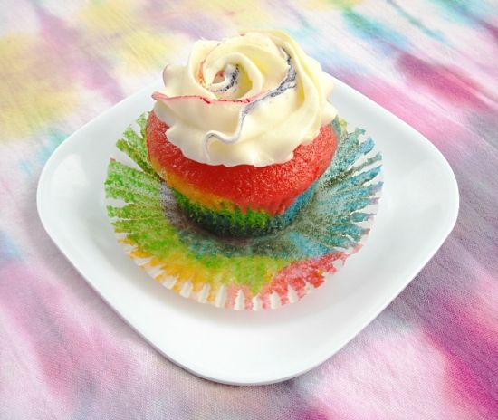 Rainbow cupcake with buttercream frosting.