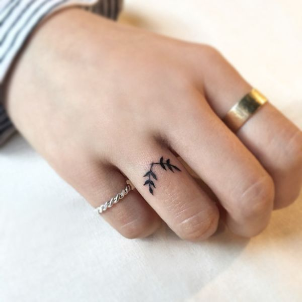 Attractive Wedding Ring Finger Tattoo For Women
