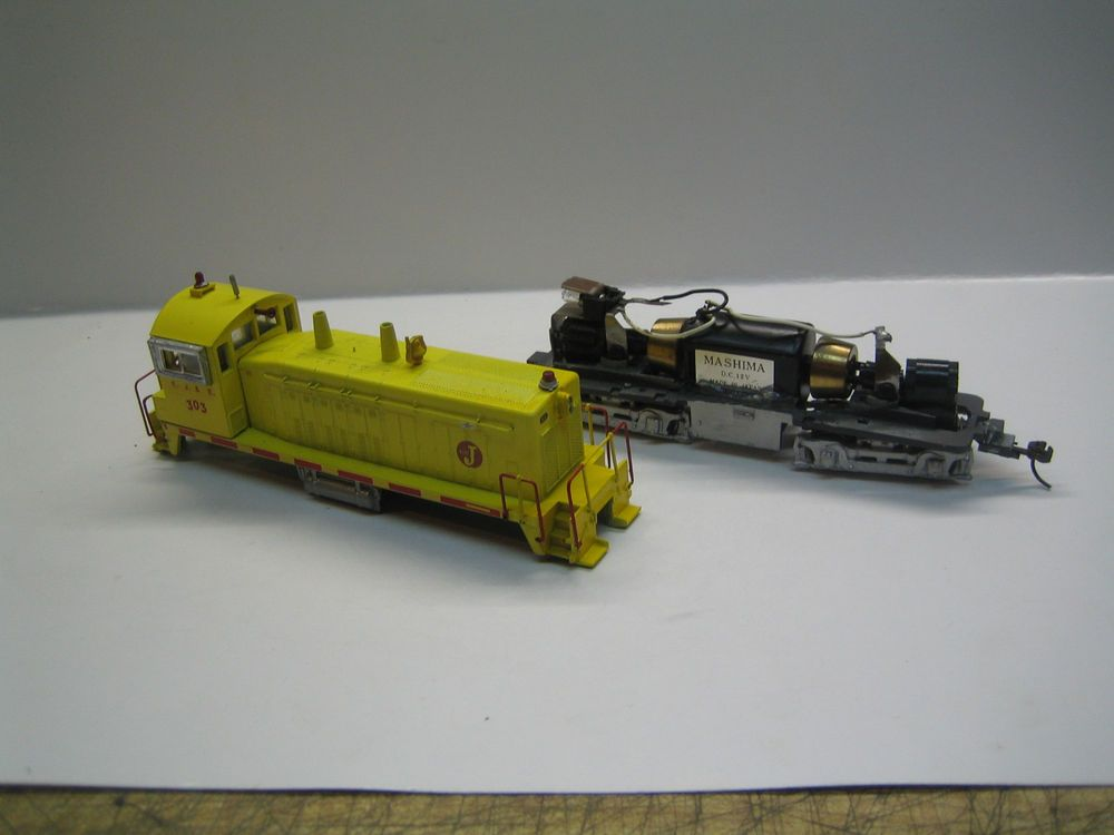 Athearn EJ&E SW1200 re motored with Mashima motor and flywheels