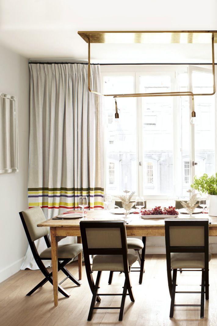 Pierre Freyu0027s dining room with modern brass