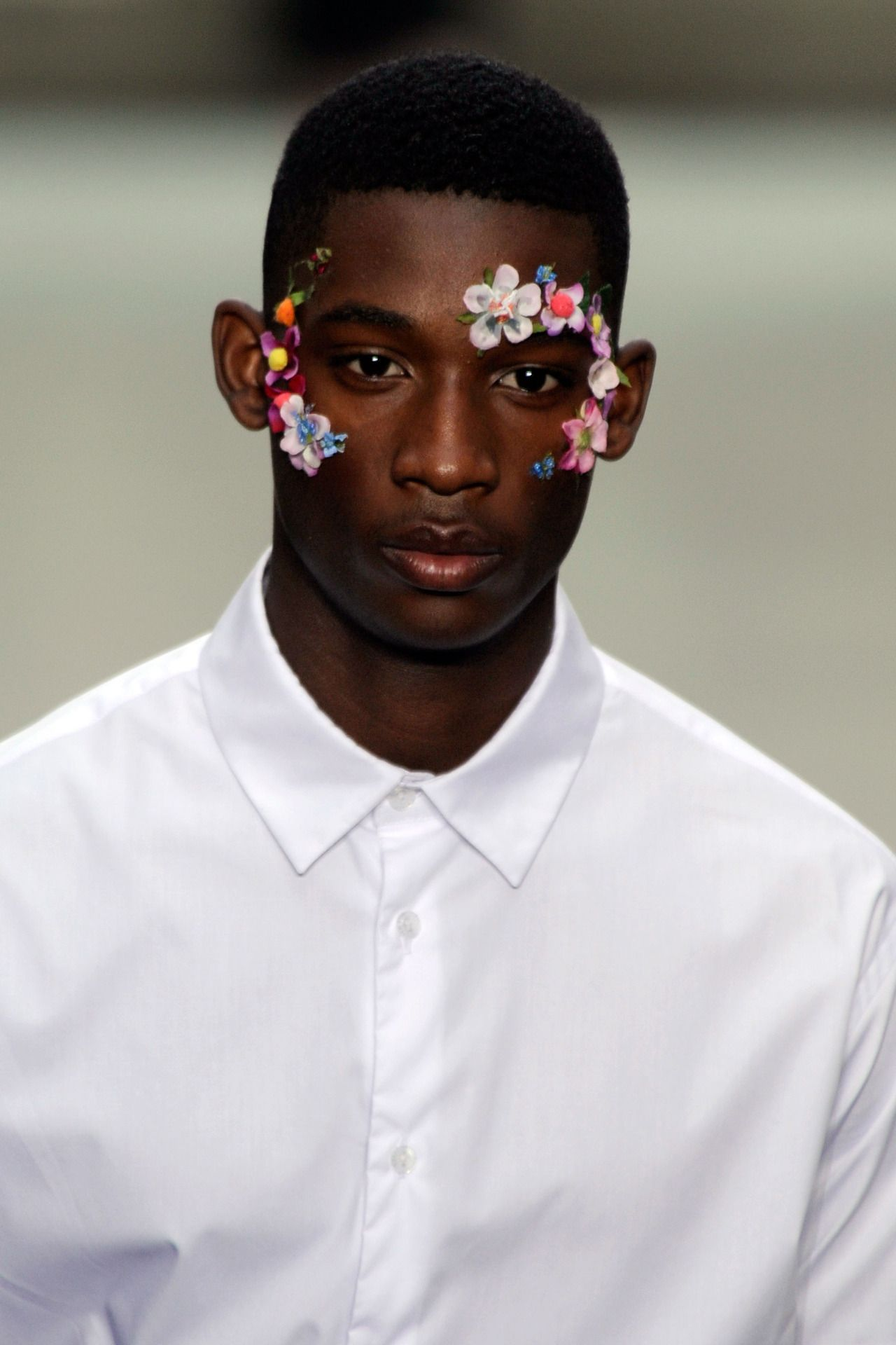 Floral face decoration at Christopher Shannon SS13 menswear show in London