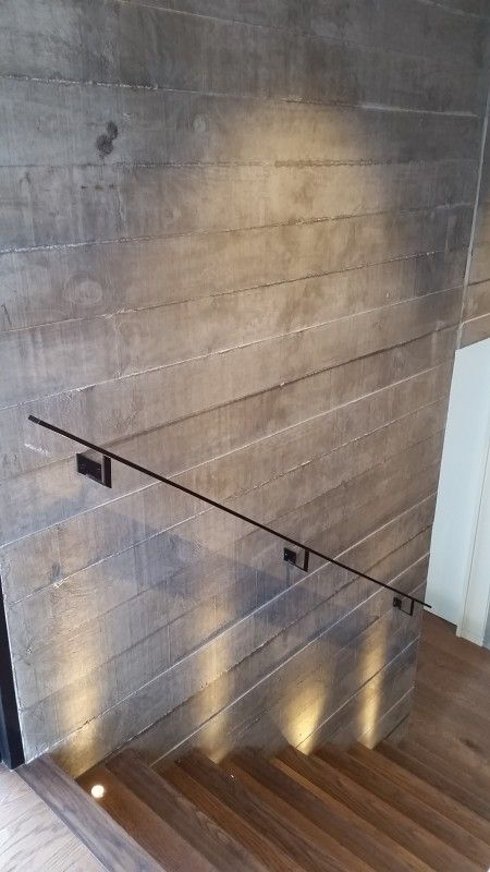 Precast Concrete Basement Walls Part - 35: Dramatic Light Effect And Shadowing On Off Shutter Timber Grain Precast  Concrete Wall, Sleek Flat Cast Iron Handrail.
