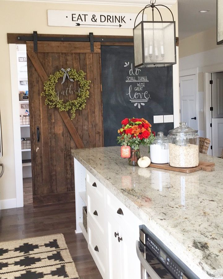 sliding barn door and chalk board wall in the kitchen ...