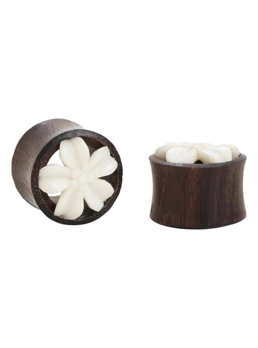 Wood plugs are a great alternative for your ears! These double flared tunnels from Urban Star have a white blossom inlay on the front to add a little more fabulousness to your ears. Just try not to wear them in water. Note: wood body jewelry may vary in size +- 0.5mm.