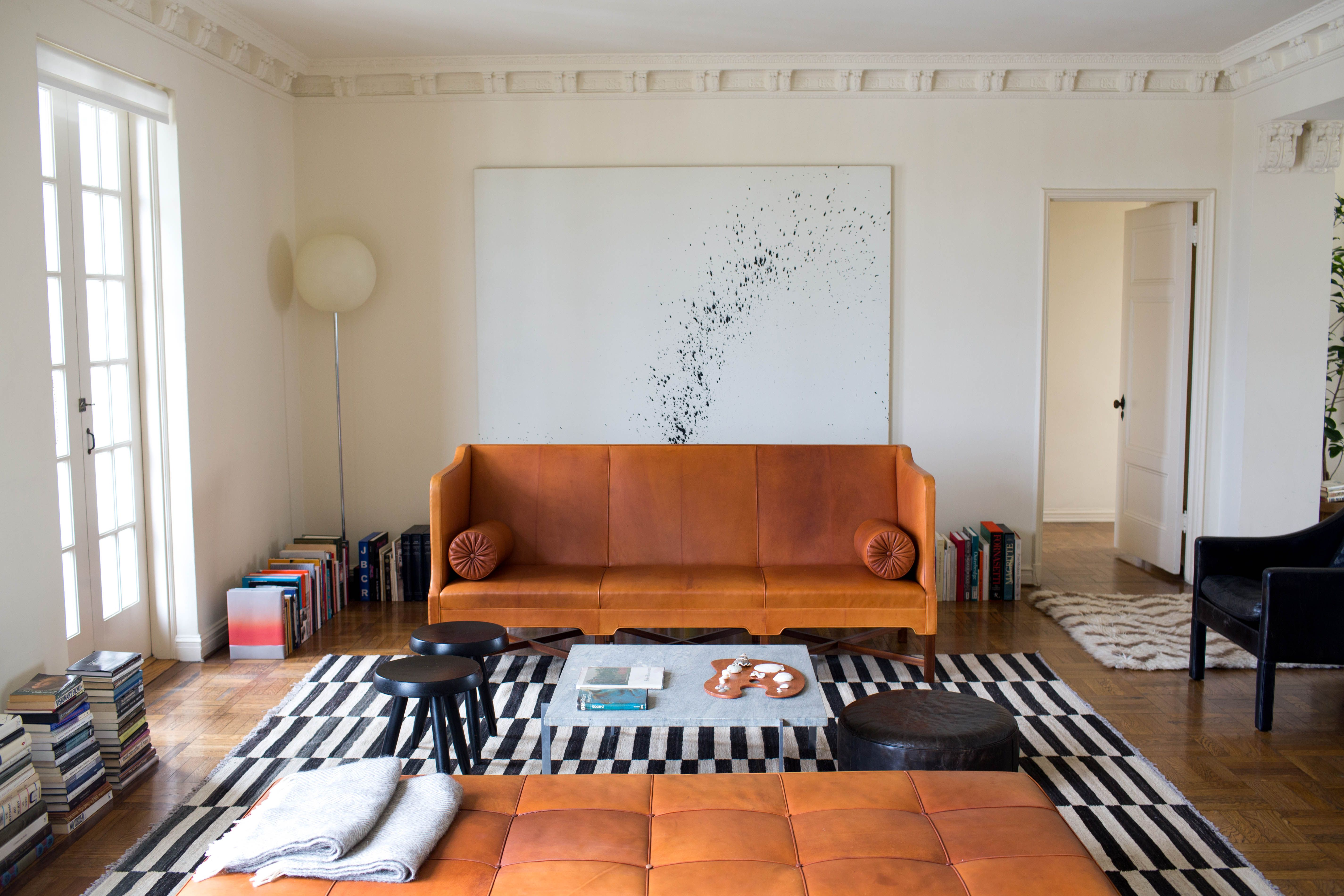 Lisa Overduin LA House for Rip Tan, black and white rug, leather vintage sofa, artwork