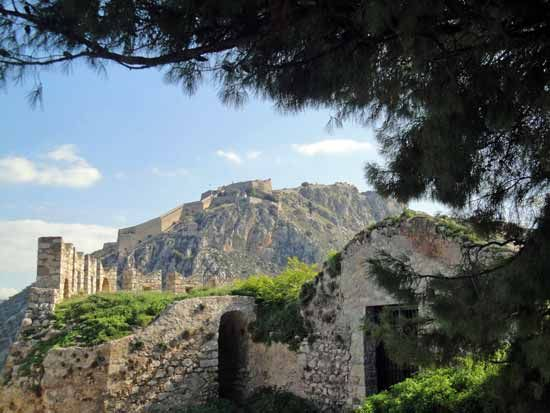 View of Palamidi, the castle topping the hill overlooking the old town of #Nafplio in the #Peloponnese.  Photo taken from the road crossing through the ruins of #Akronafplia Castle at the tip of the peninsula.