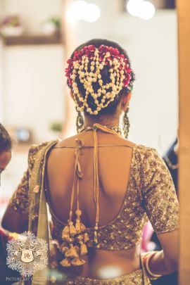 Bridal Details - Jai & Nayana wedding story | WedMeGood | Copper Blouse with Gajra and Roses in Hair #wedmegood #indianbride #gajra #bridalhair #blouse #weddingblouse #gold