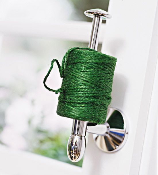 Use old toilet paper holder to keep twine organized and where you left it.