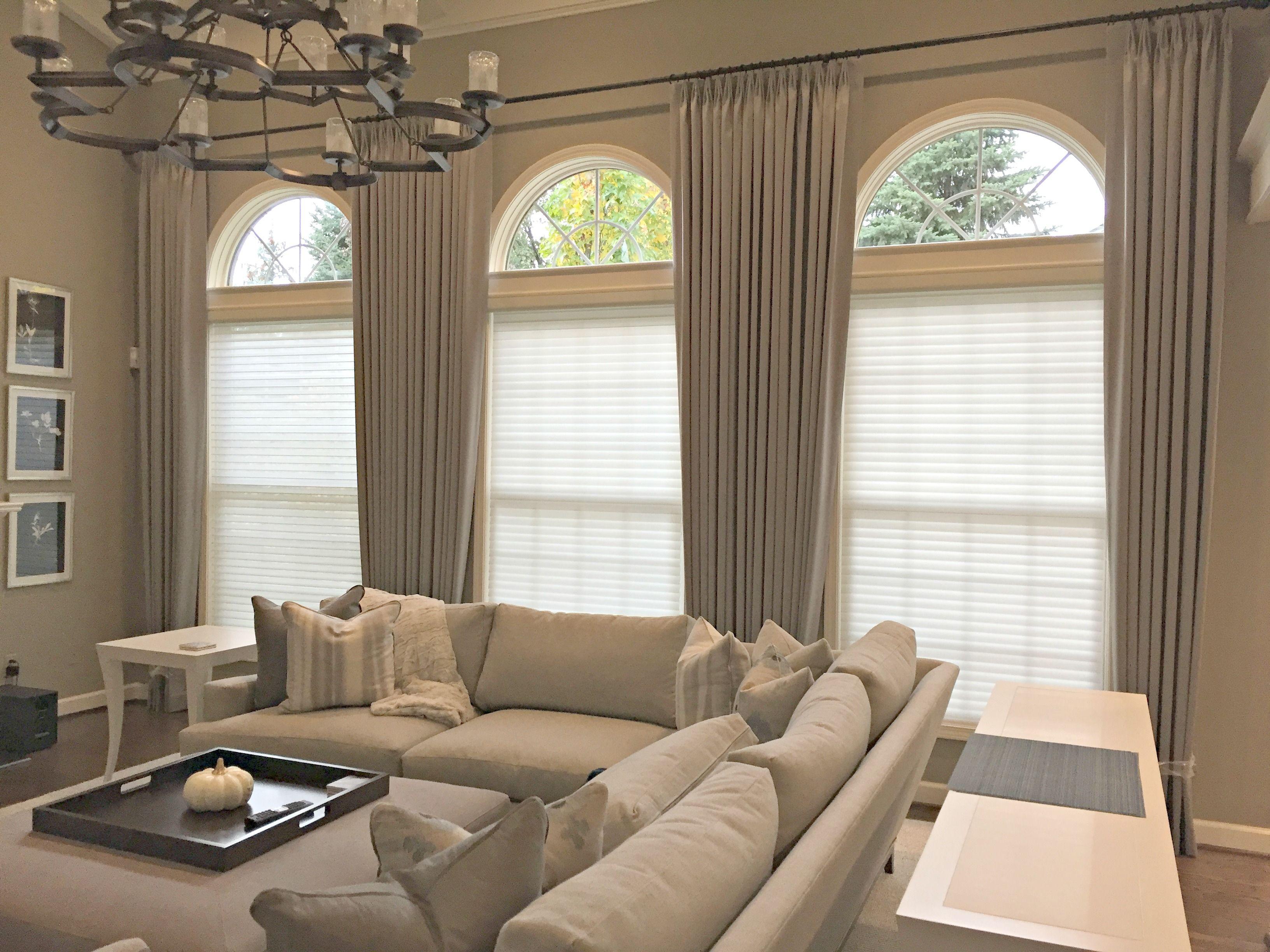Creamy Grey Drapery Panels Beautifully Showcase Three Grand Ar