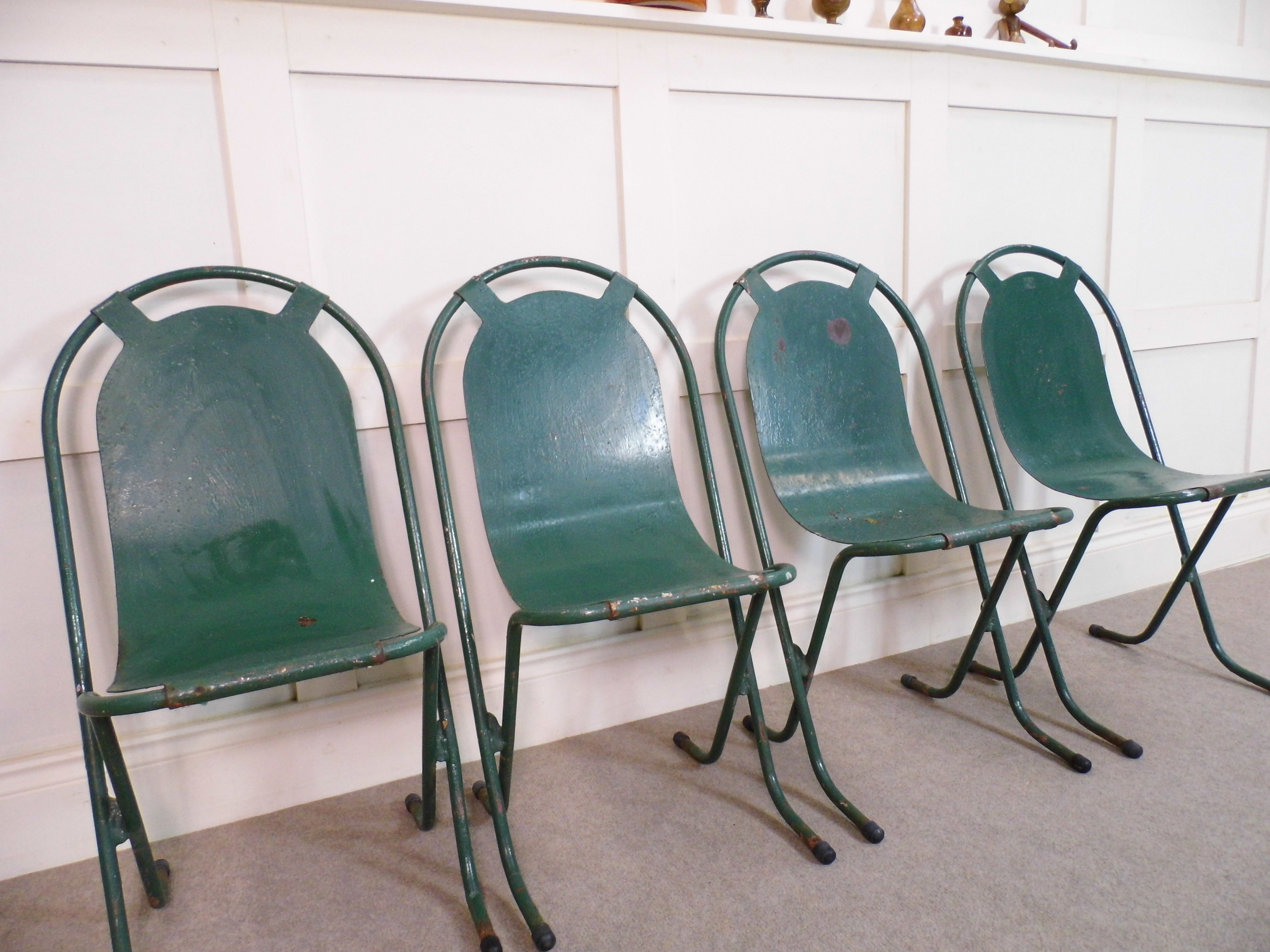Vintage stacking metal chairs by Sebel stack a bye tubualr