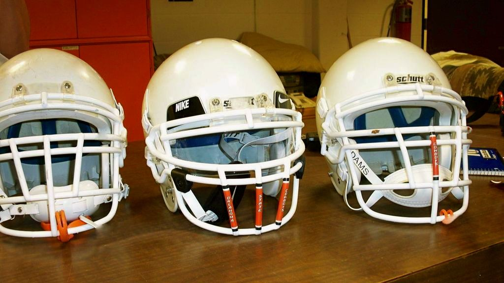 Before and after of a football helmet with intentional