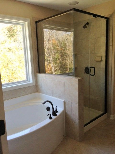 Master bath with semi-frameless shower & separate garden tub.