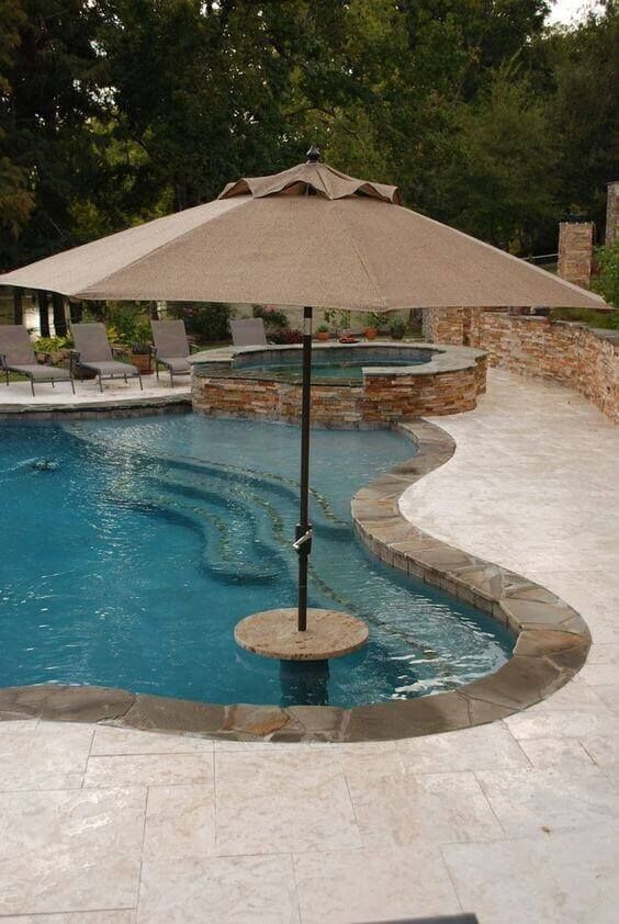By Going With A Swimming Pool With Jacuzzi Design You Can Enjoy Your Yard All Year Long So Decide The Swimming Pools Inground Swimming Pool Photos Pool Patio