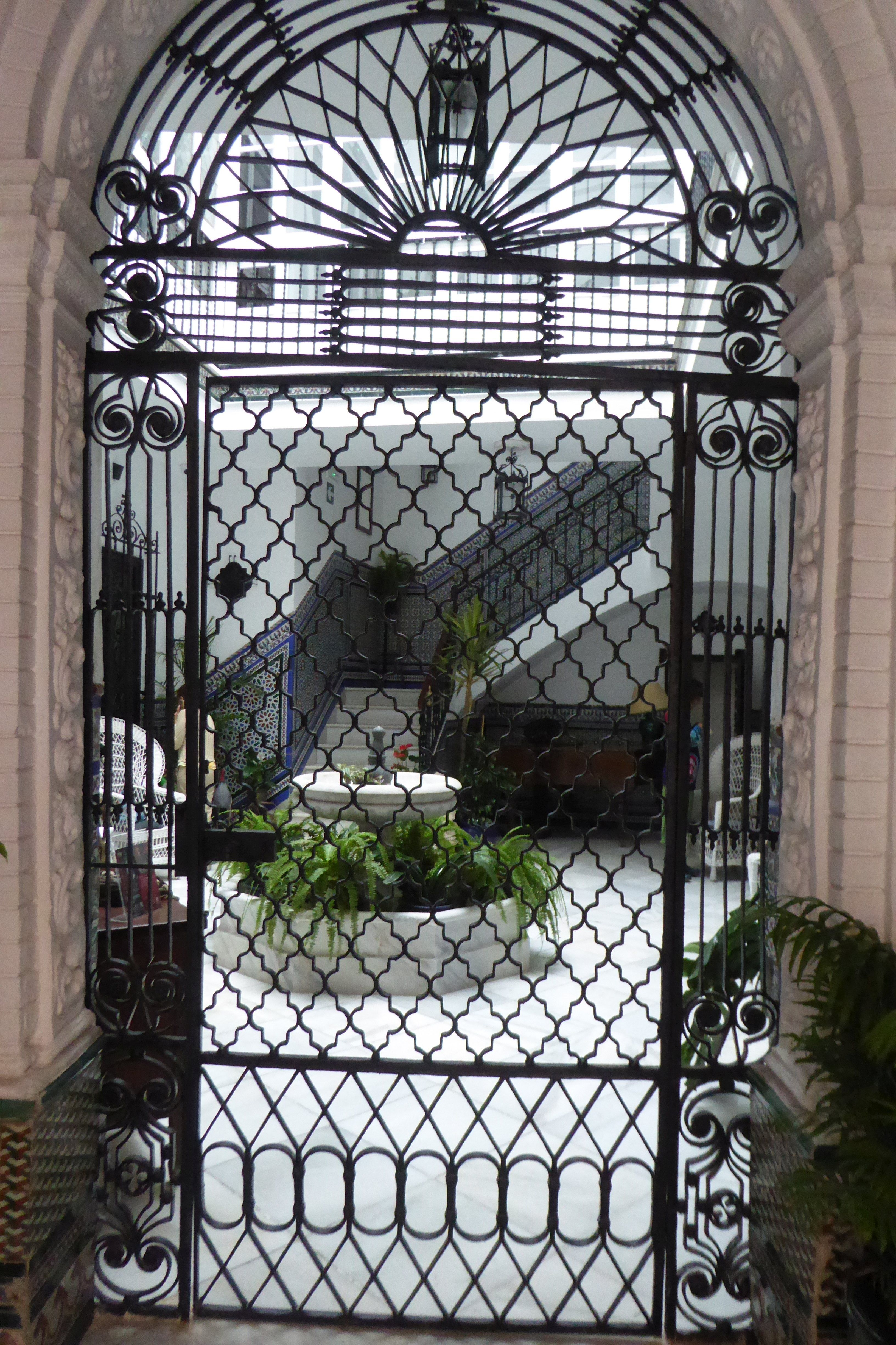 Wrought Iron Door Gate To A Courtyard At A Private Residence In