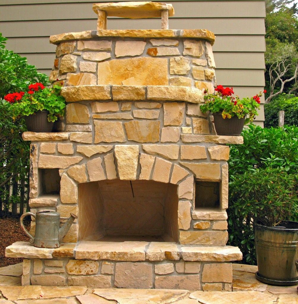 Stone fireplace with built in ledges idea BACK YARD