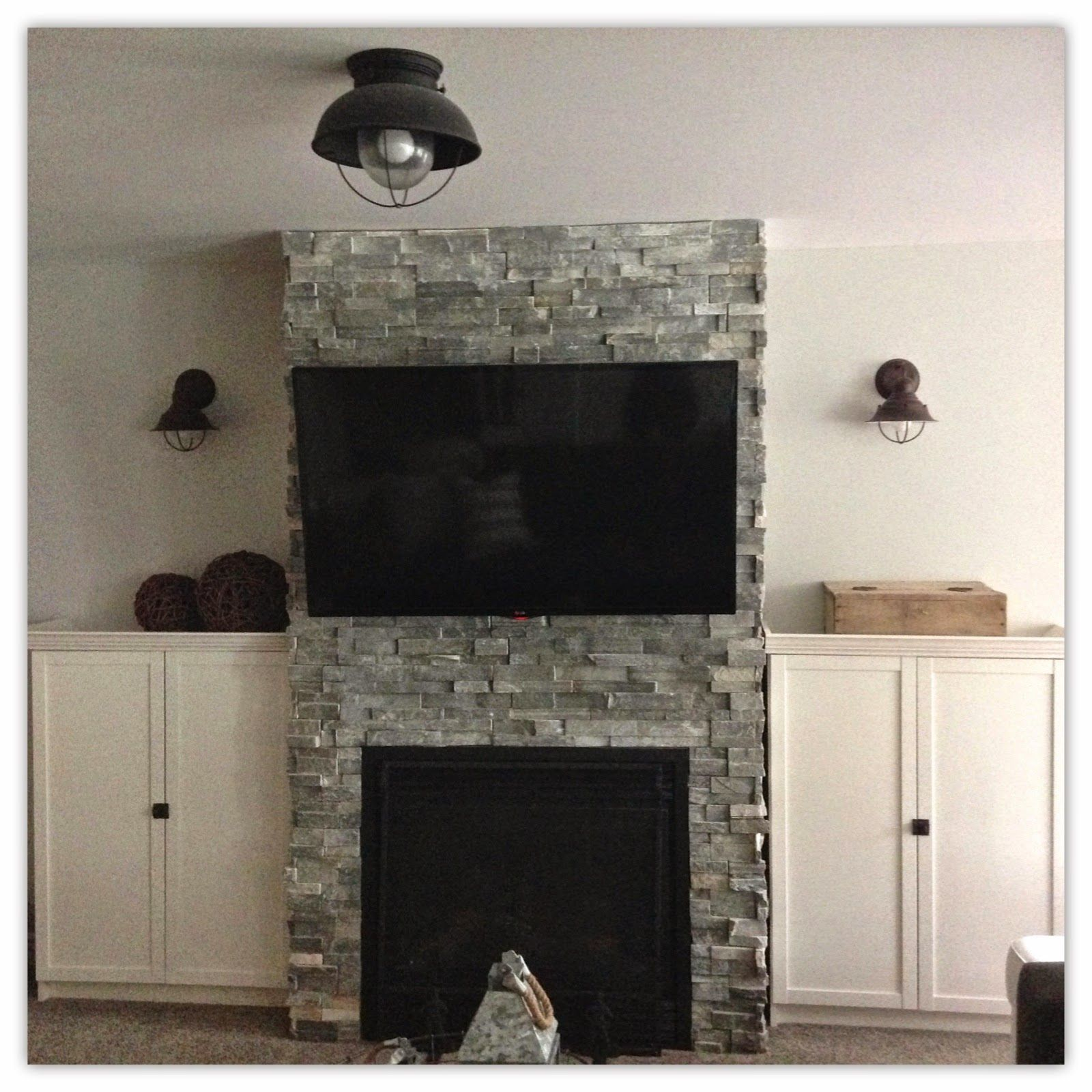 Basement Family Room Reveal sierra blue ledge stone fireplace ikea