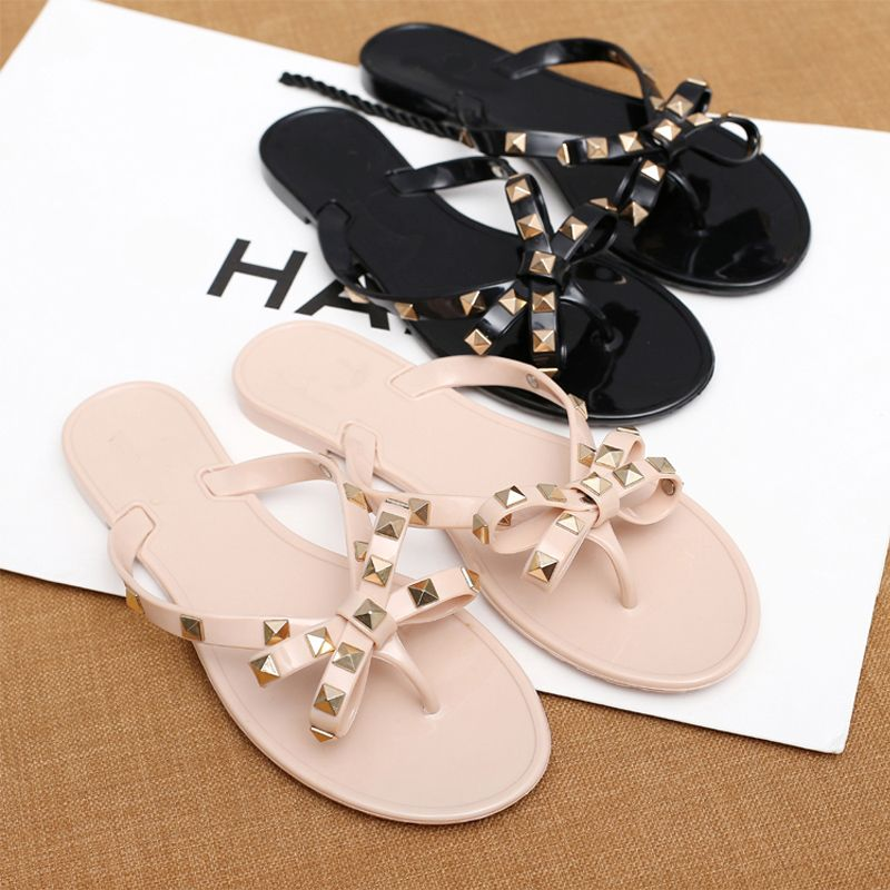 ff3ab70d2 2017 Designer Women Flat Slippers Rivets Bowknot Girls Flip Flops Summer  Shoes Cool Beach Jelly Shoes-in Slippers from Shoes on Aliexpress.com