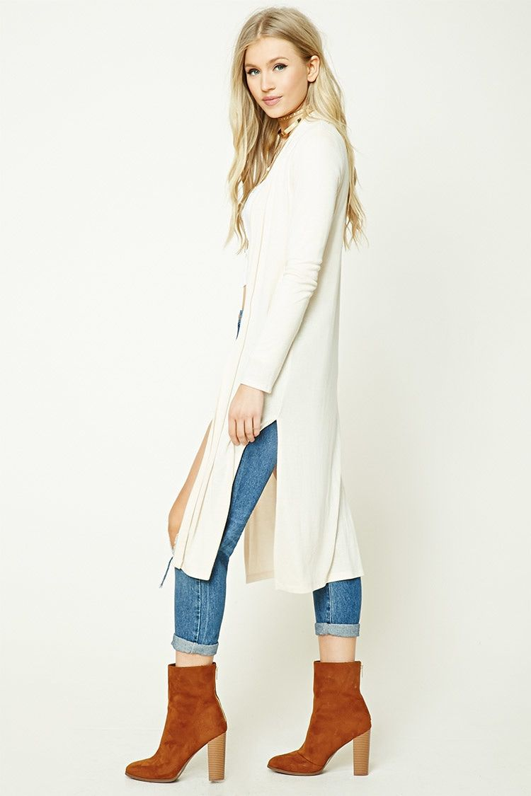 A lightweight knit cardigan featuring side slits, and open front, and long sleeves.
